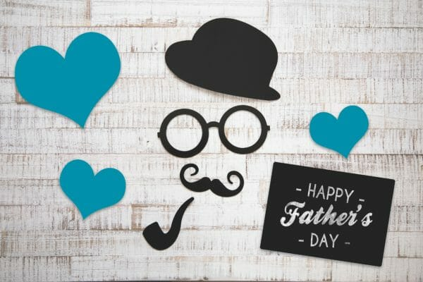 Paper cutouts with words that say Happy Father's Day
